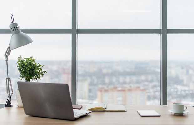 Office desk with city background symbolising notes from Headhunters desk